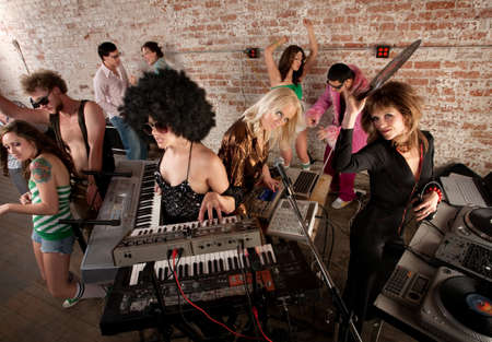 Female DJs Rocking a Disco Music Party photo