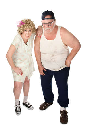 wife beater: Snickering older couple with dirty clothes on white background