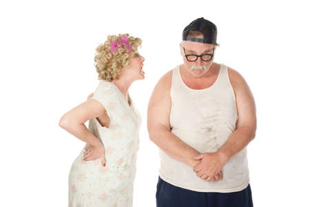 wife beater: Bickering wife yelling at a shamed husband Stock Photo