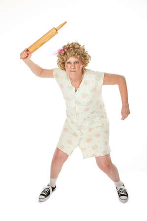 whack: Angry housewife with rolling pin on white background