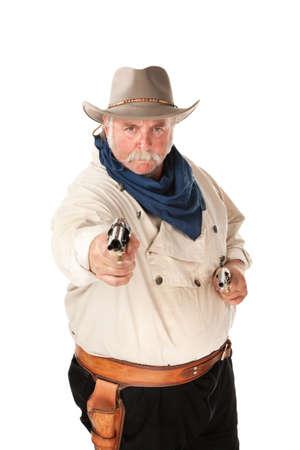 Big cowboy pointing pistols on white background photo