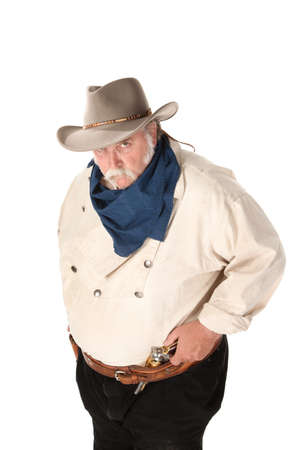 Big tough cowboy with moustache and pistol in belt photo