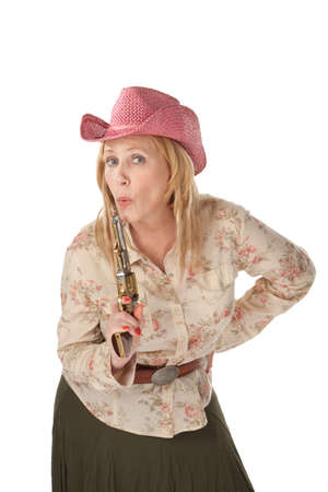 recently: Woman with pink cowboy hat with a recently used pistol