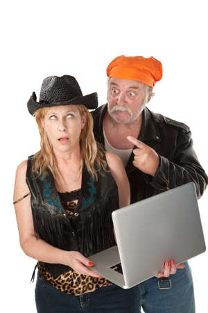 internet porn: Couple bickering over things on their laptop computer Stock Photo