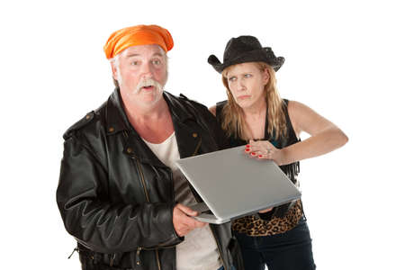 hick: Embarrassed woman with a spouse viewing her laptop screen