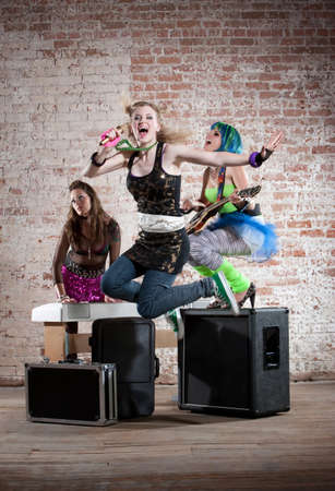 performs: Young all girl punk rock band performs in a warehouse