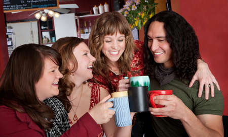 Three cute girls flirting with a handsome Native American man at a cafe photo