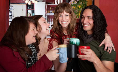 Four chummy friends hanging out at a bistro Stock Photo - 7505644