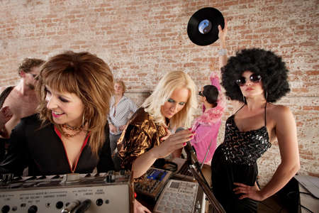 Three female DJs performing at a 1970s Disco Music Party Stock Photo - 7505687