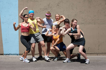 Group of friends have fun posing after a run.