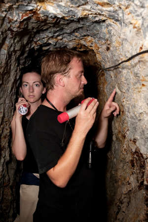 Couple exploring rustic abandoned gold mine in Costa Rica Stock Photo - 7566844