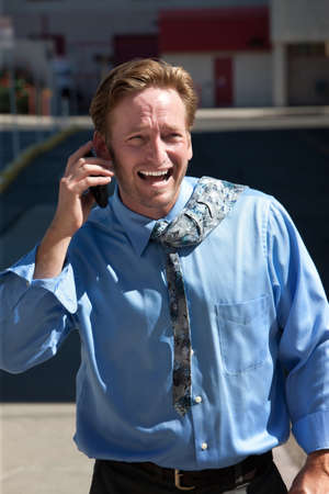 harried: Handsome man is excited about his phone call.