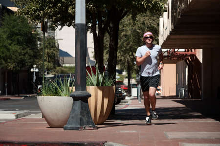 Single male out for a run in the city. photo
