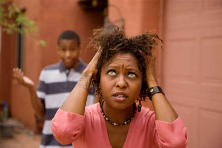 Worried single-mother with son pulling her hair photo