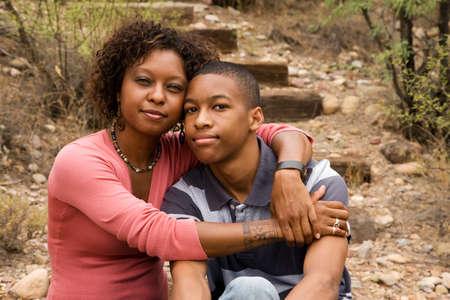 Loving single-mother hugging her handsome teenage son Stock Photo - 7564868