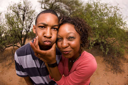 single-parent mom and son being silly outdoors Stock Photo - 7564856