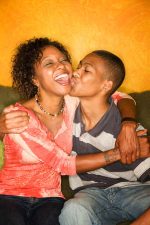 smooch: Attractive African-American woman with teen family member