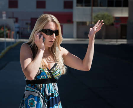 harried: Woman is confused by what she hears. Stock Photo