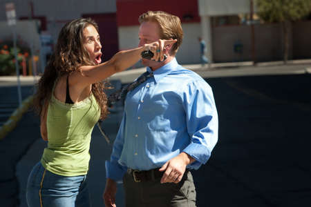 Man and woman have intense discussion on a city street. photo