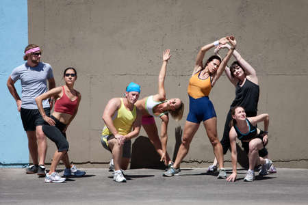 Group of runners stretches before going for a run. Stock Photo