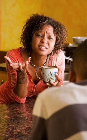 distraught: Distraught African-American woman and male have serious discussion Stock Photo