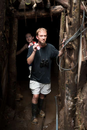 Couple exploring rustic abandoned gold mine in Costa Rica photo