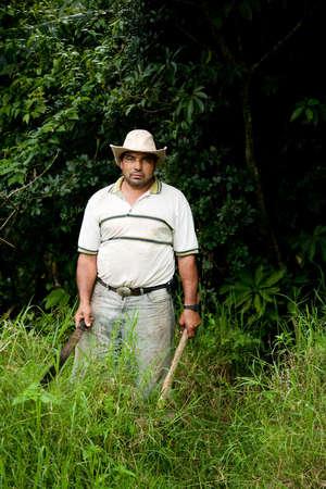 Costa Rican ranch hand with a machete Reklamní fotografie
