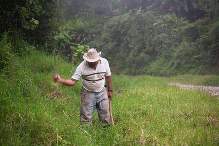 rican: Costa Rican ranch hand with a machete