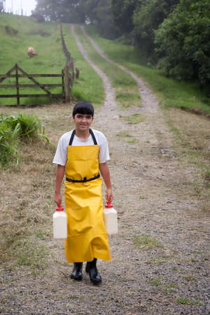 Young boy working on Costa Rican dairy farm photo