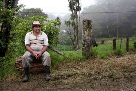 costa rican: Wide angle shot of Costa Rican ranch hand by the side of the road