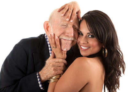 young to old: Rich elderly man with Hispanic gold-digger companion or wife