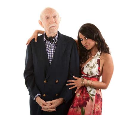 Rijke oudere man met Spaanse gouddelver metgezel of vrouw