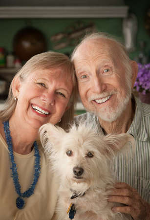 Senior couple with cute white dog