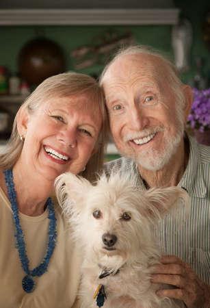 senior citizen: Senior couple with cute white dog