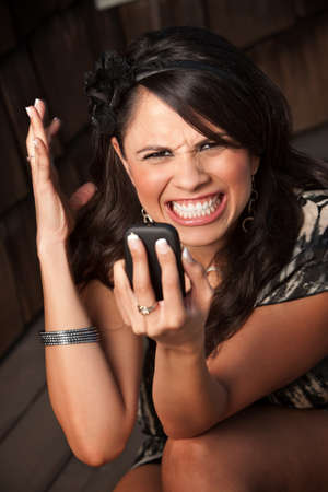 woman on phone: Beautiful Woman Receiving Call or Text on her Cell Phone Stock Photo