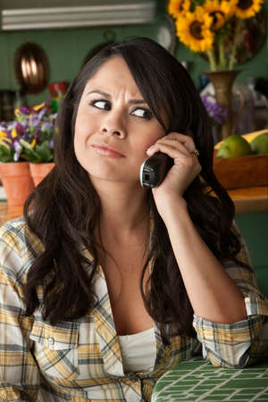 interruption: Frustrated Latina Woman on Phone  Waiting for Service or taking Sales call