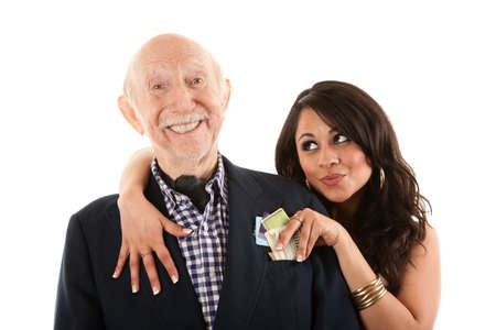 Rich elderly man with Hispanic gold-digger companion or wife photo