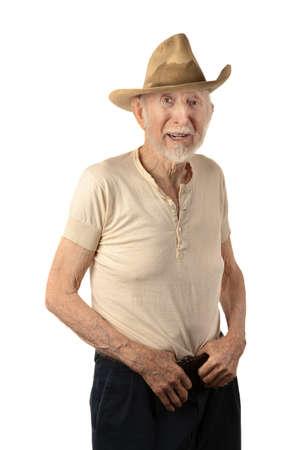 hombre sucio: Grungy vaquero senior con un sombrero de te�ido de sudor