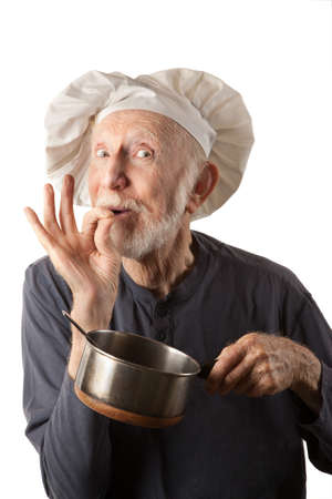 cowboy beard: Funny senior chef with big white hat and pot of beans