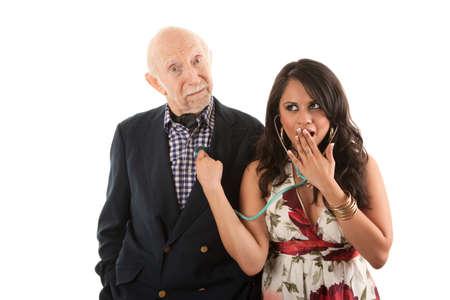 Rijke oudere man met Spaanse gouddelver metgezel of vrouw  Stockfoto - 8251775