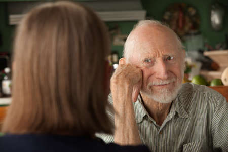 Senior couple at home in kitchen focusing on angry man Stock Photo - 8575678