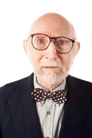 Expressive Senior Man with Bow Tie on White Background photo