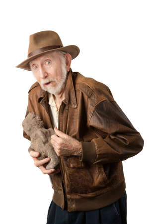 archaeologist: Adventurer or archaeologist in brown leather jacket with stolen idol Stock Photo