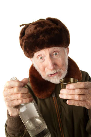 Senior Russian Man in Fur Cap and Jacket with Vodka