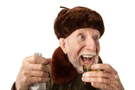 russian man: Senior Russian Man in Fur Cap and Jacket with Vodka