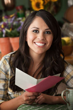 Beautiful Latina Woman at Table in Kitchen Greeting Card