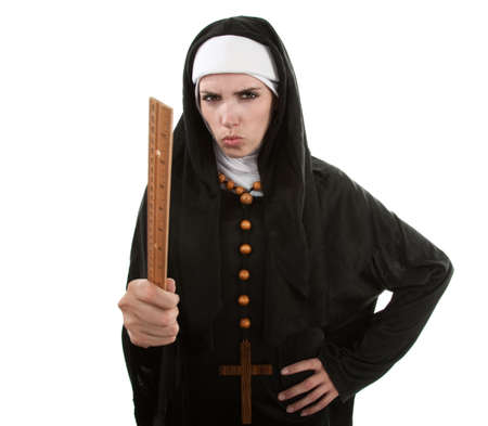 Angry Young Catholic nun pointing with a ruler photo