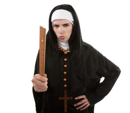 klerus: Angry Young katholische Nonne zeigen mit einem Lineal