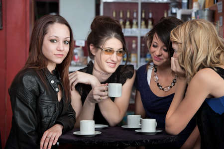 teenaged girls: Four cute teenaged girls hanging out in a cafe