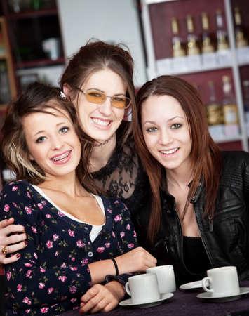 teenaged girls: Three teenaged girls having a good time at a coffee house Stock Photo